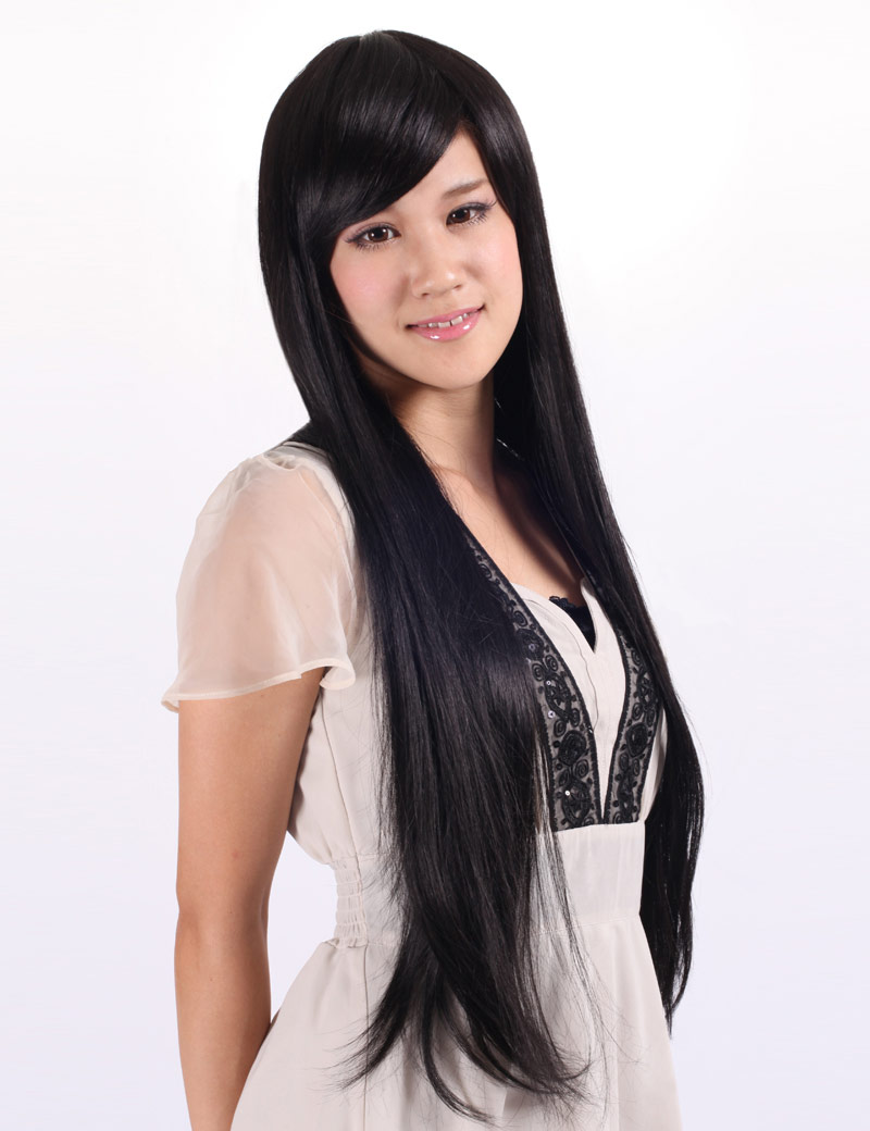 This hairstyle is clean and neat in appearance as the hair is perfectly styled on the head. It is a classy look as this wig has straight hair very long with a center part. On the forehead, straight bangs fall down to eye level, covering the entire forehead.
