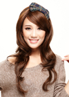 This wig styles is very long and straight with wavy bottom and the hair falls evenly at both sides. The long hair down at the side of the face has been curled outwards at the ends. The look is clean and stylish.